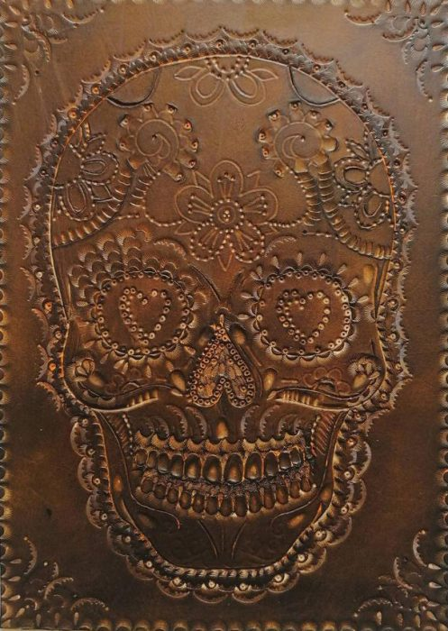 SK34 30 x 21cm Hand carved on leather. £150.00